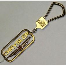 """Брелок """"Сhrysler"""" из желтого золота с рубином.."""