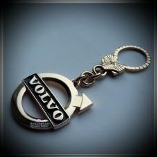"""Брелок """"Volvo"""" из желтого золота с эмалью и чёрным бриллиантом.."""