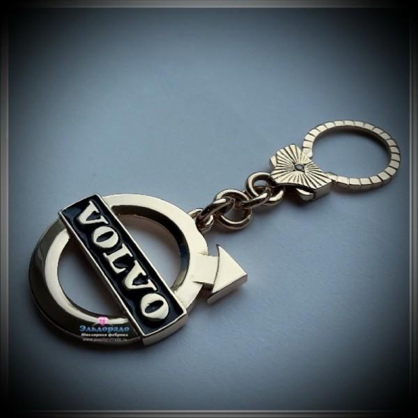 """Брелок """"Volvo"""" из желтого золота с эмалью и чёрным бриллиантом"""