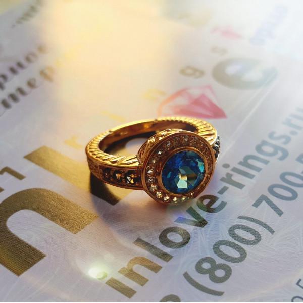 Золотой перстень с топазами