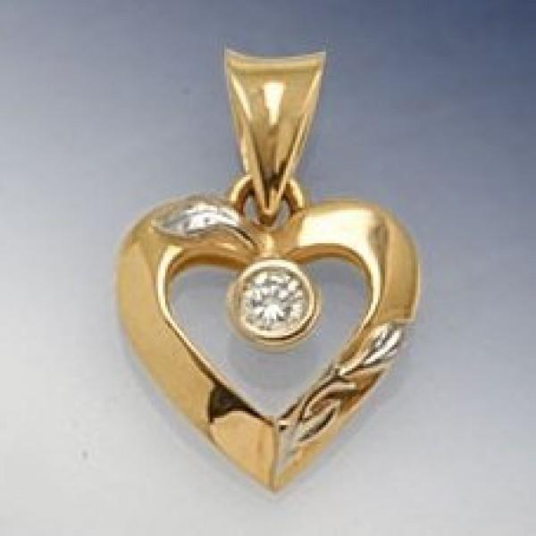 Кулон из комбинированного золота с бриллиантом
