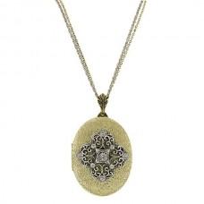 Медальон из комбинированного золота с бриллиантами..