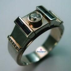 Перстень из белого золота с бриллиантом и турмалинами..