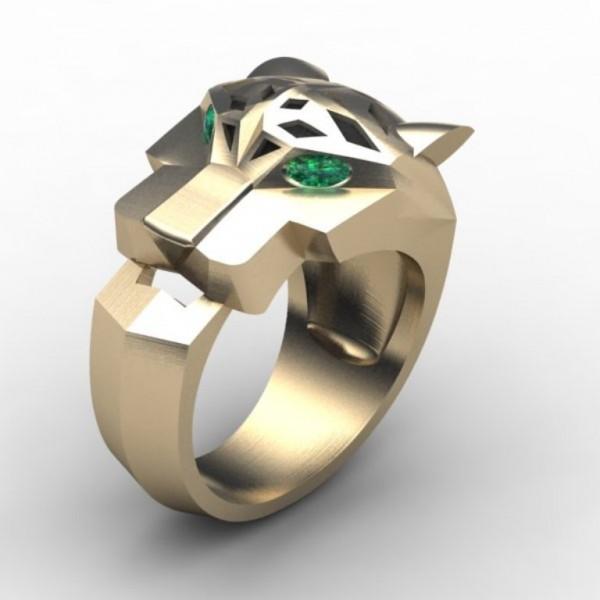 Перстень из белого золота с изумрудами