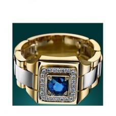 Перстень из комбинированного золота с синим сапфиром и бриллиантами..